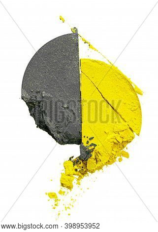 Crushed Eyeshadows Of Illuminating Yellow And Ultimate Gray Colors Isolated On White