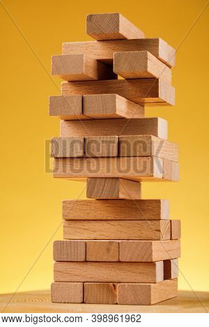 The Concept Of Entrepreneurial Risk. Wooden Blocks On A Yellow Background
