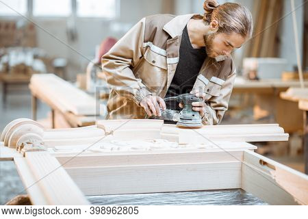 Carpenter Grinding Joinery Product With Carvings, Finishing Woodwork At The Carpentry Manufacturing
