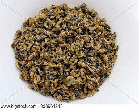 The Leaves Of Red Tea Dian Hong Van. Dianhong Tea. Chinese Red Tea Golden Curls. Dianhong Jin Luo. R