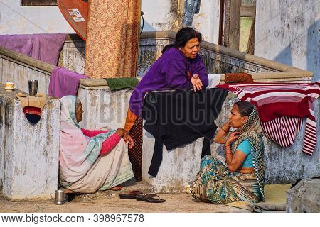 Varanasi, India - Dec 26, 2019: Unidentified Indian Women With Her Colorful Scarf. Scarf Made Of Ind