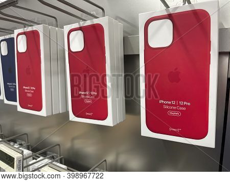 Frankfurt, Germany - December 10th 2020: A German Photographer Comparing Accessories As Phone Cases