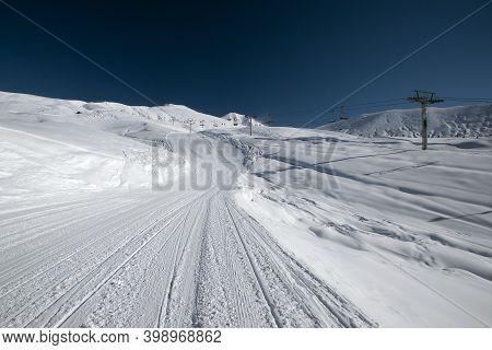 Recently Prepared Ski Piste, Ski Lift And Snowy Mountains. Winter Ski Resort. Copy Space. Gudauri, G
