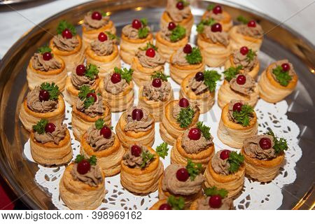 Tartlets Of Cod Liver Pate With Green Leaf Grapes Placed On A Round Plate. Cooking Delicacies, Healt