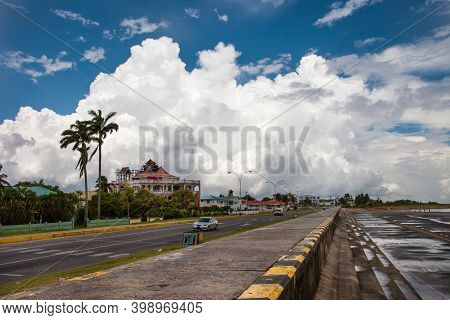 View Of The Protective Concrete Flood Dam From The Ocean Against The Background Of Thunderclouds On