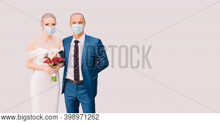 Bride And Groom In Medical Masks On An Isolated Background. Wedding For Two During Isolation, Covid-