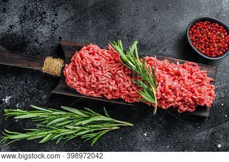 Fresh Raw Mince Beef, Ground Meat With Herbs And . Black Background. Top View
