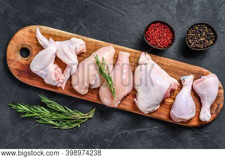 Fresh Raw Chicken Meat And Chicken Parts. Black Background. Top View