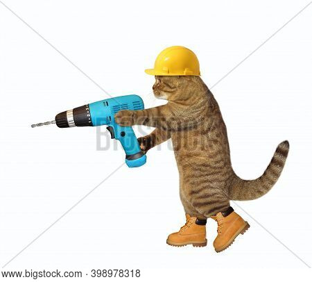 A Cat Worker In A Yellow Construction Is Holding A Blue Hand Electric Drill. White Background. Isola