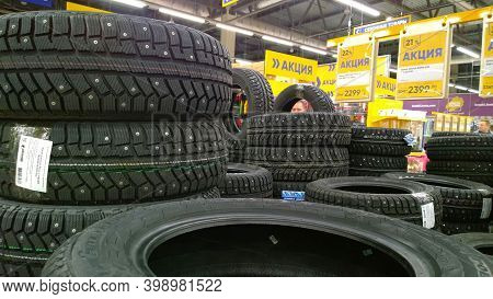 St. Petersburg, Russia - October 11, 2020: Stack Of New Studded Tires For Sale In A Supermarket. Dis