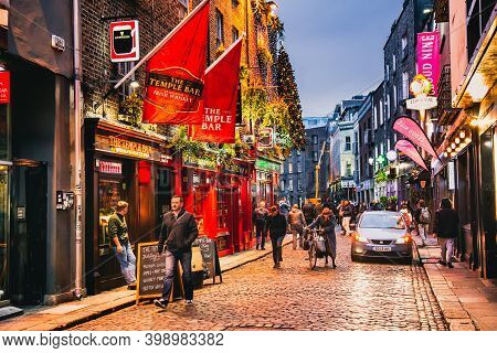 Dublin, Ireland - November 8, 2018: Famous Pub Temple Bar In Autumn. Christmas Tree, Decorations Abo