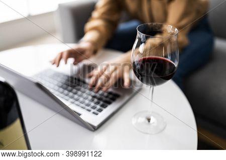 Virtual Wine Tasting Dinner Event Using Laptop