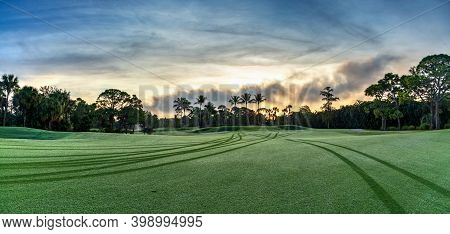 Dawn Breaks Over The Golf Cart Paths Along The Grass Of A Golf Course In The Bahamas.