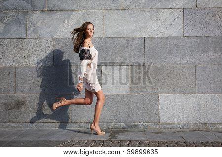 Young Beautiful Woman Runs