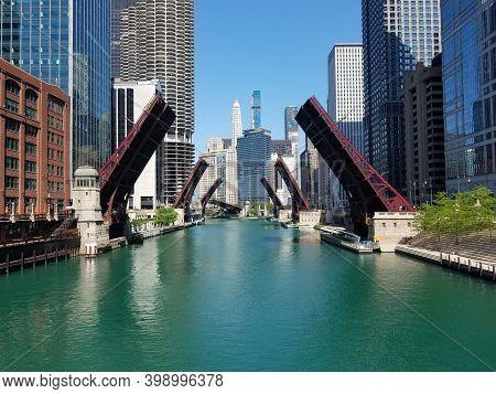 Chicago, Il June 2nd, 2020 Chicago River Bridges Drawbridges Raised Elevated Under A Clear Blue Sky