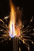 pyrotechnic burning fire and sparks closeup on black background poster