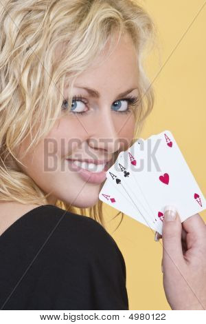 Beautiful Woman Holding All The Aces