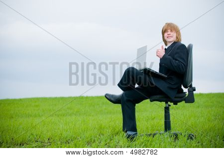 Handsome Young Businessman With Laptop