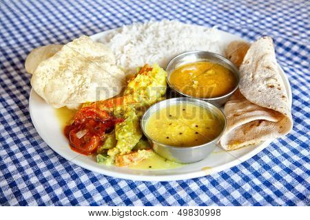 Indian traditional vegetarian thali food in restaurant poster