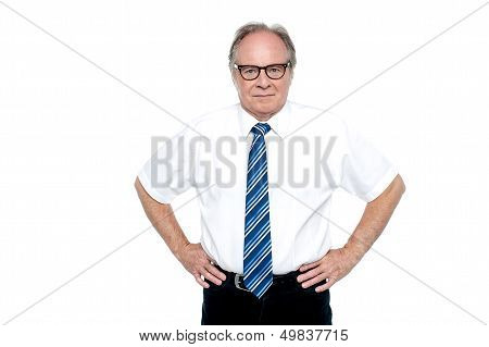 Confident Business Tycoon Striking A Pose