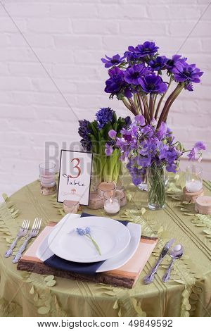 Purple and Green Reception Table Setting