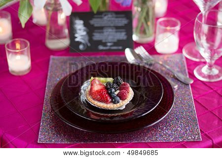 A Pink and Purple Table Setting