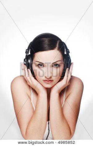 Brunette Looking At Camera Wearing Headphones