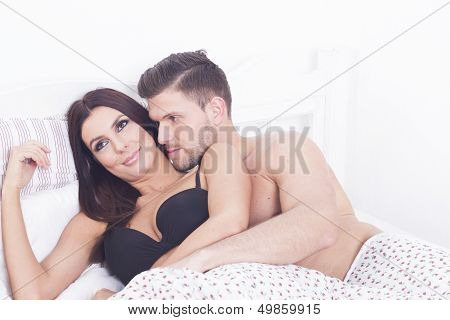 Sexy heterosexual passion couple in the bed