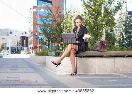Businesswoman Making Lunch Outdoor In The City