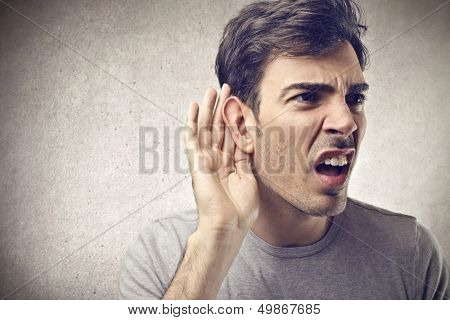 curious man listens with ear