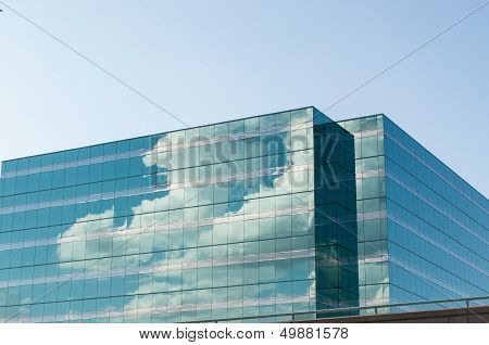 Modern Office Building Reflecting The Clouds