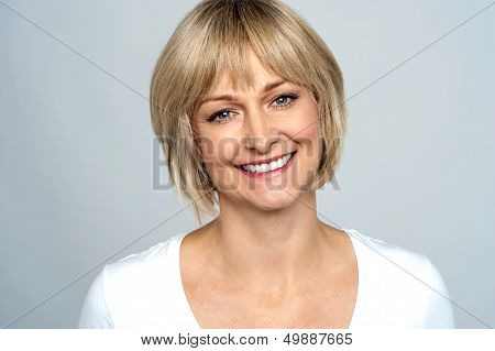 Portrait Of A Smiling Middle Aged Caucasian Woman