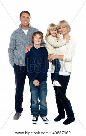 Happy Family Posing In Trendy Winter Wear Outfits