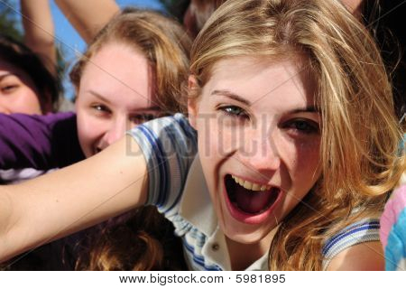 Teenage Fans Screaming And Reaching Out For A Celebrity