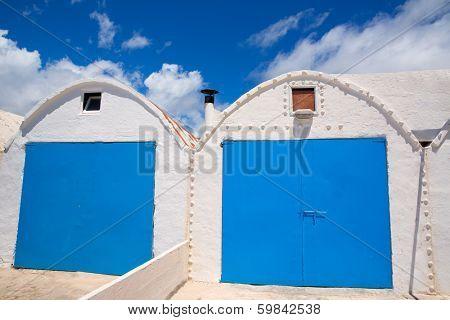 Menorca Punta Prima white Mediterranean beach house facades in Balearic islands