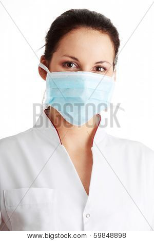 Young nurse in mask , isolated on white background