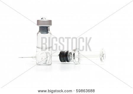 Syringe And Vials On White
