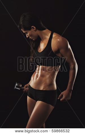 Muscular Female Doing Bodybuilding Training