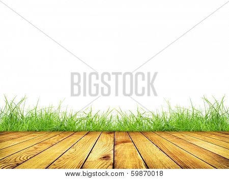 Wooden planks with green grass on white background