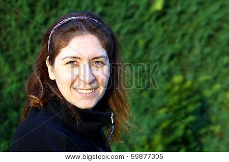 Turkish Women Smiling With A Green Backround
