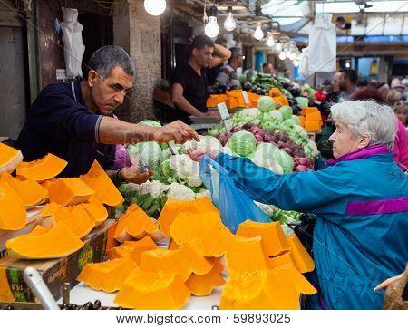 Jerusalem, Israel - November 15, 2012: People are shopping at Mahane Yehuda - famous market in Jerusalem