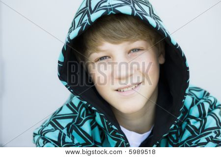 Boy In Hood Smiling To Camera