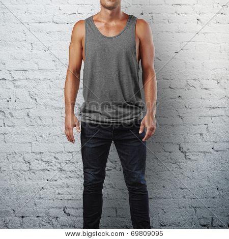 Man wearing sleeveless shirt