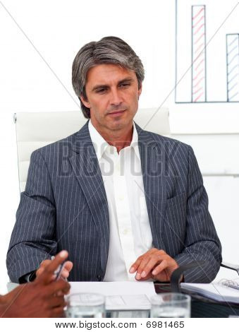 Serious Mature Manager In A Meeting