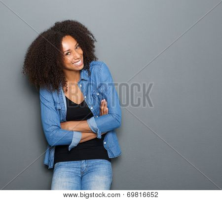 Happy Young Woman With Arms Crossed