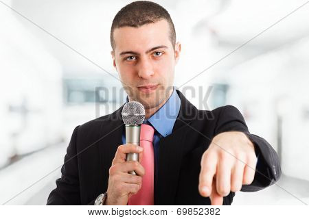 Portrait of a man speaking in a microphone