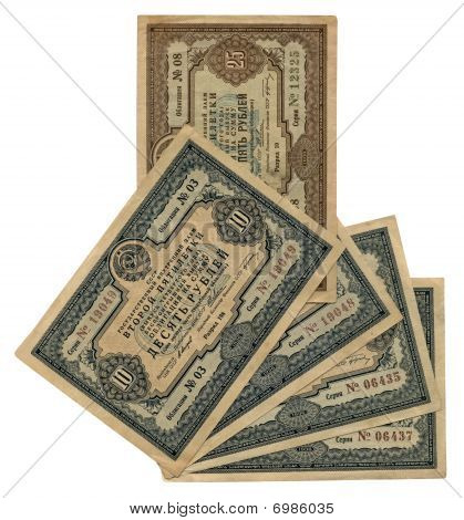 old vintage ten twenty five (10 25) soviet roubles closeup macro paper texture isolated on white background. 1930s russian promissory note nostalgia punitive measure time. poster