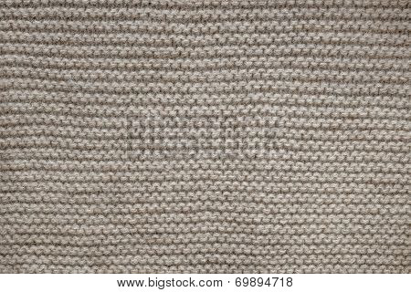 Knit texture of undyed natural brown wool knitted fabric with garter stitch pattern as background