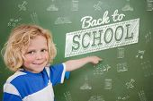 Composite image of back to school message against cute pupil pointing poster