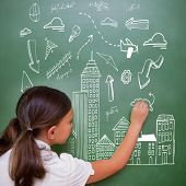 Cityscape doodle against cute pupil writing on chalkboard poster